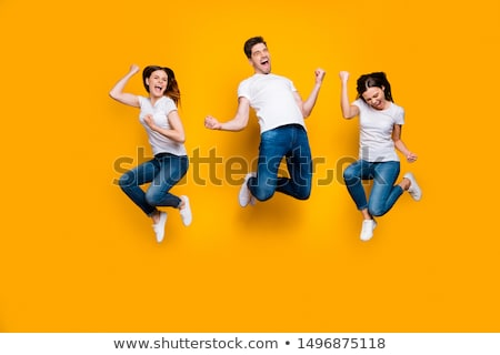 Full length portrait of a cheery happy man celebrating success stock photo © deandrobot