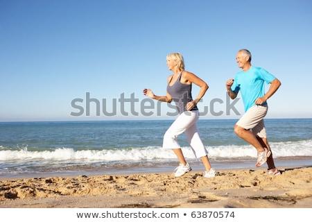 Jogging strand vrouw glimlachend geluk Stockfoto © IS2