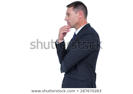 smart businessman thinking with hand on chin stock photo © stokkete