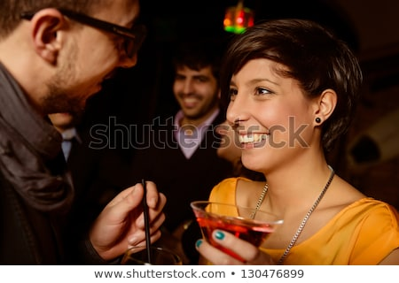 Three young women dancing on a bar counter  stock photo © monkey_business