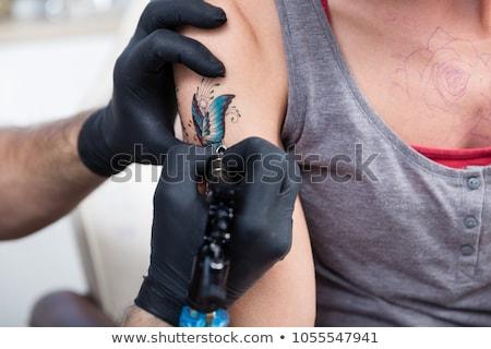 férfi · nő · kaukázusi · férfi · tetoválás · művész - stock fotó © kzenon