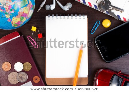 Overhead view of basic travel objects on map  Stock photo © tab62