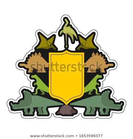 Dinosauro scudo simbolo segno bestia cappotto Foto d'archivio © MaryValery