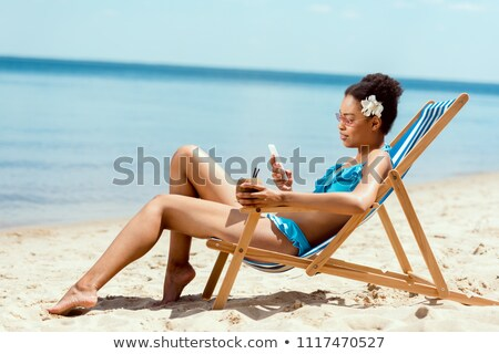 Young attractive woman relax on the sea beach Stock photo © karandaev