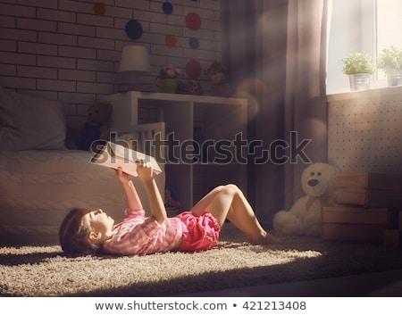 aranyos · kislány · olvas · könyv · könyvtár · portré - stock fotó © lopolo