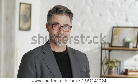 A Good looking man in glasses, portrait at home Stock photo © Lopolo