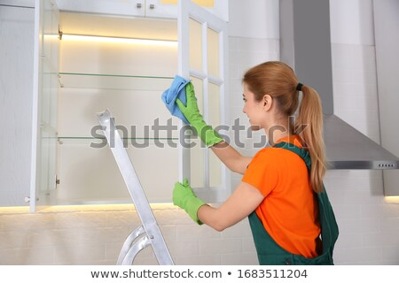 Gondnok takarítás polc szalvéta mosolyog érett Stock fotó © AndreyPopov