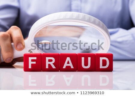 Magnifying Glass Over The Fraud Word Stock photo © AndreyPopov