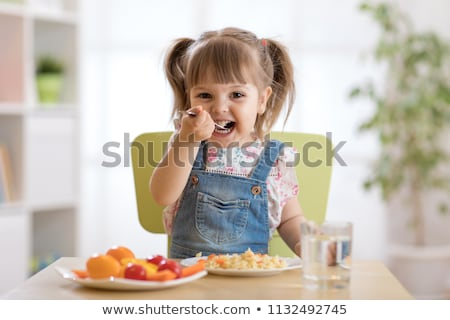 A baby child eats food at the nursery Foto stock © Lopolo