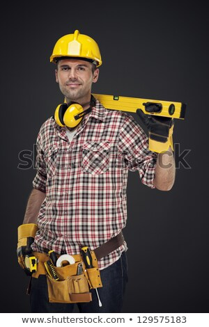 construction worker with hand on ear  stock photo © vladacanon