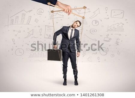 Fantoche empregado documentos em torno de grande mão Foto stock © ra2studio