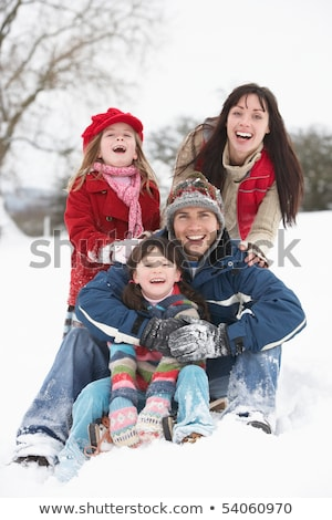 Young Family Having Fun In Snowy Landscape Stock photo © monkey_business