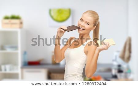 Boldog nő eszik étcsokoládé fehér egészséges étkezés Stock fotó © dolgachov