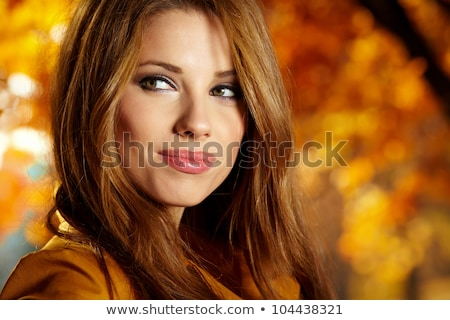 Beautiful autumn woman in golden park Stock photo © Lopolo