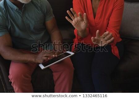 Dijital tablet oturma kanepe Stok fotoğraf © wavebreak_media