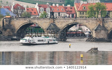 Passenger boat on the cityscape Prague background. Stock photo © artjazz