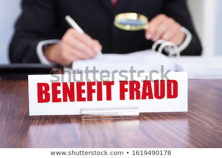 Nameplate With Benefit Fraud Title On Wooden Desk Stock photo © AndreyPopov