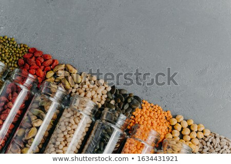 Zero waste. Organic grains in glass jars. Pumpkin seeds, chickpea, mung beans, lentils, goji berry,  Stock photo © vkstudio