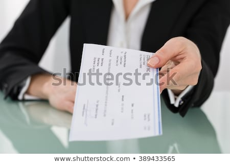 Signing Compensation Pay Cheque Stock photo © AndreyPopov