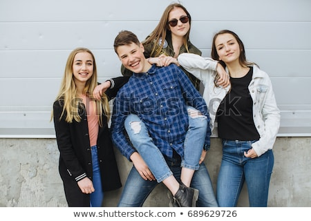 Group of teenagers hanging out on the street Stock photo © bluering