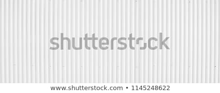Vertical corrugated metal plates background Stock photo © boggy
