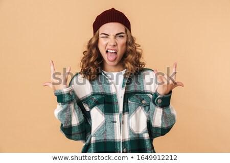 Fotó fiatal nő kacsintás készít agancs ujjak Stock fotó © deandrobot