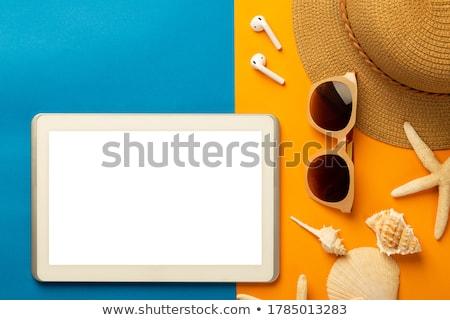 tablet computer and seashells on beach sand Stock photo © dolgachov