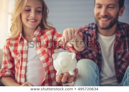 Aranyos fiatal nő pénz persely portré vonzó Stock fotó © williv