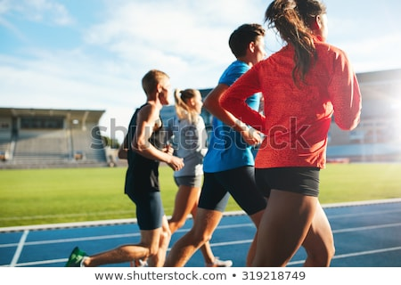 afbeelding · runner · lijden · been · kramp · stadion - stockfoto © pressmaster