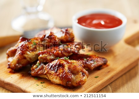barbecued honey chicken wings stock photo © zkruger