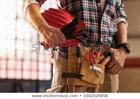 Hombre herramientas caucásico manitas rojo perforación Foto stock © tiero