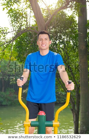 Man using an elliptical machine in an outdoor gym Stock photo © photography33
