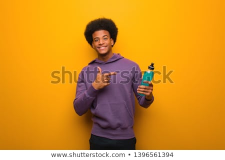 Man holding black bottle or product Stock photo © lovleah
