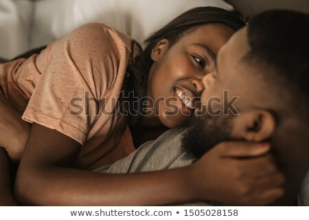 Happy young women with arms around her husband Stock photo © get4net