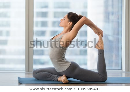 eka pada rajakapotasana one-legged king pigeon pose Stock photo © dolgachov