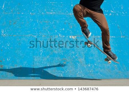 Skateboarder Man Doing an Ollie Jump Stock photo © ArenaCreative