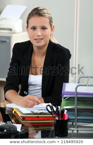 Blond receptionist sat at her desk Stock photo © photography33