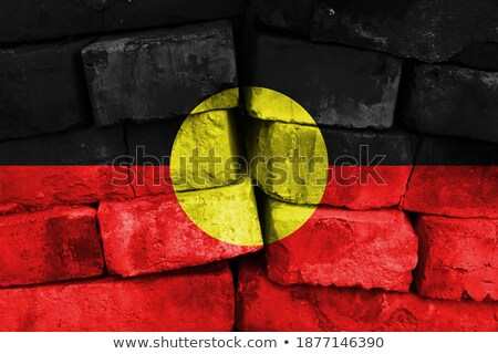 Flag of Aborigines on brick wall Stock photo © creisinger