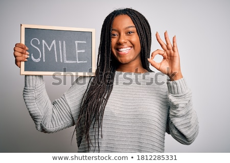 teenager holding the at symbol stock photo © photography33