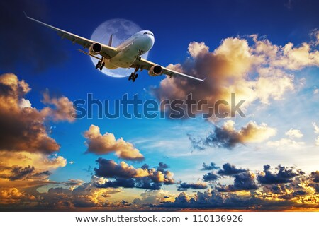 jet aircraft after take off in a spectacular sunset sky stock photo © moses