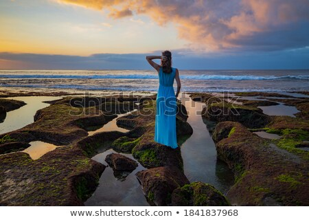 Woman wearing a dress with a low back Stock photo © photography33