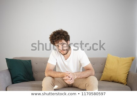 Pensive looking boy posing with hands clasped Stock photo © stockyimages