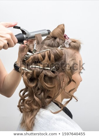closeup woman with hair rollers Stock photo © carlodapino