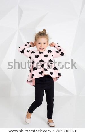 Lovely young blonde in black leggings Stock photo © acidgrey