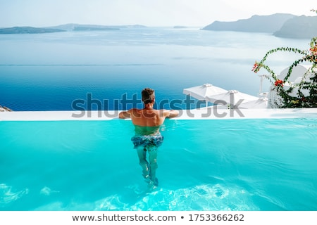 Сток-фото: Man Relaxing By The Pool