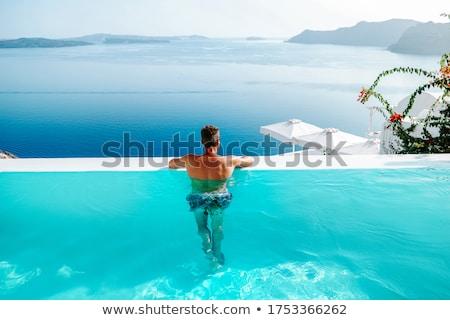 Сток-фото: человека · расслабляющая · бассейна · счастливым · портрет · темно