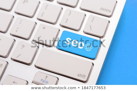 Blue key with Optimization word on laptop keyboard. Stock photo © REDPIXEL