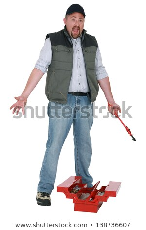 Annoyed tradesman looking for a lost tool Stock photo © photography33