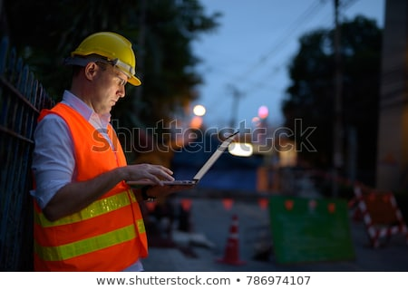 road construction worker with laptop stock photo © ndoelimages