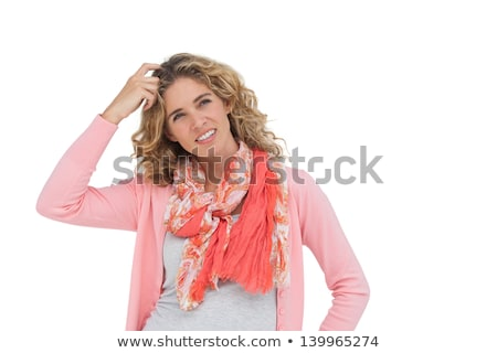 attractive woman posing and smiling while scratching her head stock photo © wavebreak_media